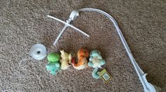 DIY Pokémon gen. 1 starters mobile for nursery. Dolls and plain white mobile found on eBay. Sew a loop into the back of each doll, then hang them from the mobile.