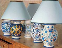 Hand-painted Italian ceramic lamps.  In a totally neutral room, what a pop of color and pattern these would be.  It's art, but it's useful