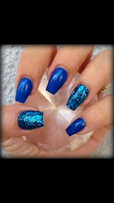 Blue dress nails in the fence