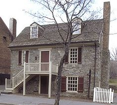 Old Stone House, located at 3051 M Street in Georgetown, was built in 1765, making it the oldest standing building in Washington, DC. The exterior of the house is constructed of locally quarried blue granite. The house was built by Christopher Layman, a cabinetmaker by trade, as both a residence and a shop.