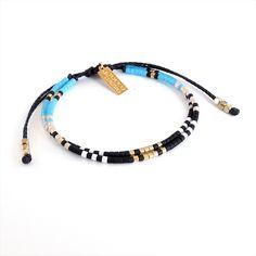 bohemian beaded friendship bracelet in glack gold, beige and sky blue
