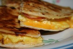 Breakfast Quesadilla  Ingredients  3 eggs  1 to 2 tablespoon of butter  Splash of half and half  2 flour tortillas  2 slices of American cheese, or any kind of shredded cheese  1 slice of deli ham, or cooked crumbled bacon