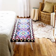 Instead of spending a fortune on a Kilim-style bedside bench, try this super easy tutorial using a bench and the rug of your choice!