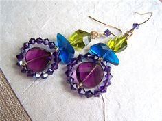 love the colors.  Purple Peacock Earrings
