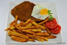 Argentina: Milanesa Completa.  Argentinians like to add herbs to their french fries, usually parsley and garlic.  Milanesa Completa, a unique take on the traditional italian Milanesa dish, breaded cutlet.  In Argentina the dish is served with two fried eggs and fries on the side. Taking a very Italian dish, and a famous french dish and combining them to make a delicious Argentinian dish.