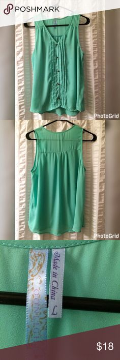 Turquoise flowy Francesca's tank top Gently used tank top can be worn all year! Is a size large but I am normally a small and wear it as a tunic with leggings. Minimal signs of wear. Please don't hesitate to ask questions or make an offer, prices are not firm! Happy Poshing! Francesca's Collections Tops Tank Tops