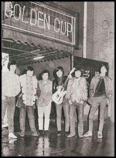 """横浜本牧のライブバー「ゴールデンカップ」の前に立つ伝説のグループサウンズ「ザ・ゴールデンカップス」。☆この写真はおそらく1966年頃。2017年現在もお店は健在!頑張って維持してくれている (インターナショナル・スクール OB) 現役ミュージシャンの先輩方がフェイスブック上でライブイベントの告知をされてます。★The Golden Cups (legendary band) in front of their live bar """"Golden Cup"""" in Honmoku, Yokohama circa late 60's. The place is maintained by the (St. Joseph OB) active musicians as of 2017 present, & the live events are being announced on Facebook."""