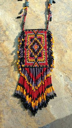 Check out this item in my Etsy shop https://www.etsy.com/listing/503997209/native-american-inspired-beadwork-amulet