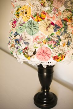 yoyo lampshade~ what a cute shade for the craft room or area