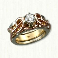 14kt Rose Gold Adare Reverse Cradle with 14kt White Rails and a 14kt Yellow Inner Band set with a .51ct Round Brillant Cut Diamond