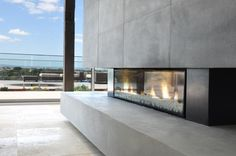 A combination of fire, water, metal and stone inspired a truly original design for this Melbourne, Australia holiday home. The sunny glass house designed by architect Richard Ekberg, channels the t…