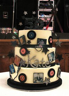 Could do a scaled down tiered cake to serve less people, or could just adopt this idea (of the small records and album sleeve) around a single tier cake