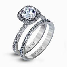 Accented by .46 ctw of glistening round cut white diamonds  this contemporary white gold halo style engagement ring and wed