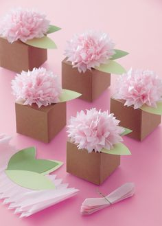 party favors... pom pom flowers match hanging tissue decor. makes 6 ($9)