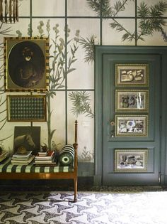 Castellini House in Milan - overscale bontanical trompe l' oeil, patterned mosaic floor, green mouldings, organic illustrations, green & white striped settee cushion..