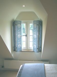 Fabric Covered Window Shutters - what a lovely idea! I could just imagine these in a pale grey linen - brilliant.