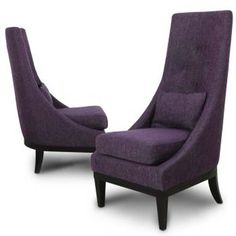 A pair of high backed statement chairs - a popular choice for contemporary spaces