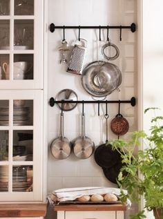 Pot Racks- towel bar and s hooks.. Easy! Love this idea for small kitchen equipment and pans