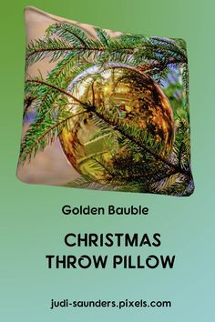 "Close-up of a Christmas Tree with a golden bauble. Our throw pillows are made from 100% spun polyester poplin fabric and add a stylish statement to any room. Pillows are available in sizes from 14"" x 14"" up to 26"" x 26"". Each pillow is printed on both sides (same image) and includes a concealed zipper and removable insert (if selected) for easy cleaning. #JudiSaunders #PhotoArtTreasures"