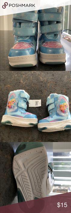 Disney Frozen boots Brand new Disney Frozen boots. Size SMALL 5/6 Disney Shoes Boots