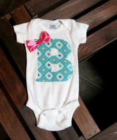 Personalized Baby Girl Onesie via Etsy... although I could make this myself...