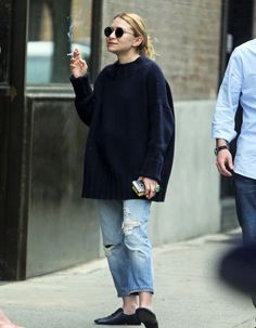 Ashley having a cigarette break outside her office in NYC on May 25, 2016 (via olsensobsessive.com)