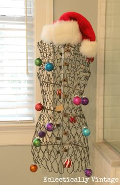 Christmas House Tours - love this home filled with tons of fabulous decorating ideas like this vintage dress form!  eclecticallyvintage.com