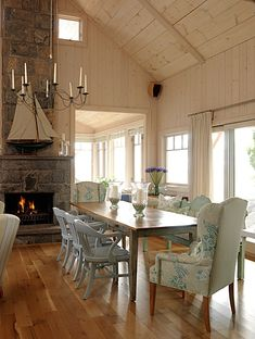High ceilings, lots of pine, nautical touches, and a huge dining table-my perfect cottage.