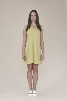 Sleeveless dress with button 185.00$