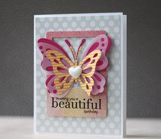 Card focuses on the coordinating (PTI) dies.Die cut butterflies are layered and framed using the new Instant Photo 1 die.