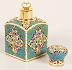 A Russian silver gilt and cloisonné enamel tea caddy, Gustav Klingert, Moscow, 1894. Of traditional form with sloping shoulders, the caddy decorated in multi-color diamond shape cartouches against a stippled gilded ground surrounded by a filigree and turquoise enamel ground, outlined by rows of white enamel beads, the dome-shape lid similarly decorated. From John Atzbach.