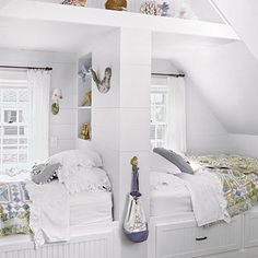 a tiny bedroom is made more functional with the addition of built-in beds with storage beneath #tiny #bedroom #storage