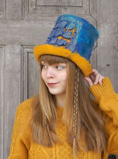 Unique felted high-hat, cylinder, top-hat, blue and yellow with 3D element with shiny golden mesh. A great addition to creating the daily and special occasions unique look! It made of merino wool and pieces of golden mesh. Unique high-hat for men or women. Light and elegant. Head circumference - 56-58 cm ( 22- 23) height - 18 cm ( 7)