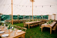 long tables under a big tent