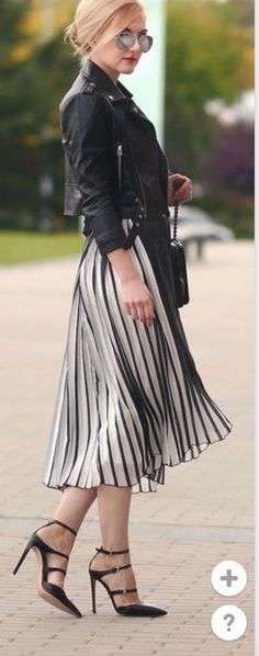 Pleated skirt + leather jacket