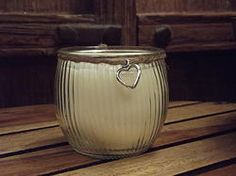 Soy wax scented candle in an elegant round glass jar.