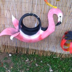 Just when you thought Lawn Flamingos couldn't get any tackier, someone goes and makes one out of an old tire! lol <3