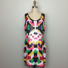 Vintage Neon Sequined Dress This is a stunning vintage trophy dress fully embellished with sequins and beading in a geometric color block design. It's in excellent condition! Comes from a smoke-free and pet-free home! Vintage Dresses