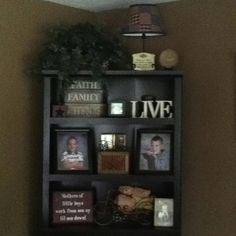 Thrift store finds and some family photos on a simple bookshelf filled my corner!