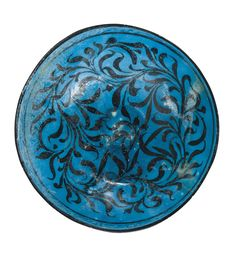 A KASHAN BLACK AND TURQUOISE BOWL WITH WATER-WEED DESIGN, PERSIA, EARLY 13TH CENTURY