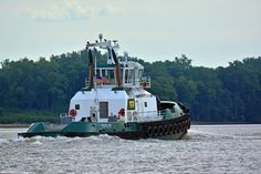 Tugboat Madeline, churning downstream.