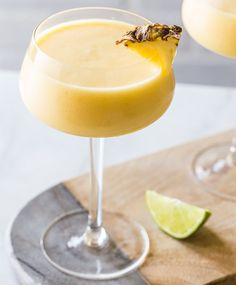 A Frozen Pineapple Mango Daiquiri is the ultimate hot weather cocktail: smooth, cold, fruity and not-too-sweet. Put them on the short list for your next summer night soirée. Mango Daiquiri, Daiquiri Cocktail, Frozen Daiquiri, Summer Drinks, Fun Drinks, Beverages, Frozen Pineapple, Frozen Drinks, Alcohol Recipes