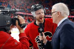 CALGARY, AB - APRIL 25: Matt Stajan #18 of the Calgary Flames is interviewed after a 7-4 win against the Vancouver Canucks at Scotiabank Saddledome for Game Six of the Western Quarterfinals during the 2015 NHL Stanley Cup Playoffs on April 25, 2015 in Calgary, Alberta, Canada. (Photo by Gerry Thomas/NHLI via Getty Images)