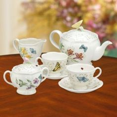 Features:  -Butterfly Meadow collection.  -Includes teapot with lid, creamer, sugar bowl with lid, 2 cups and 2 saucers.  -Crafted of Lenox white porcelain.  Color: -White.  Material: -Porcelain China