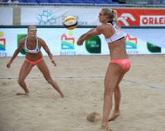 Riikka Lehtonen of Finland passes the ball to Taru Lahti looks