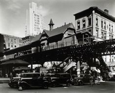 Hanover Square, Manhattan.  Elevated railroad station in lower Manhattan, cars below, cars of various eras beyond.  Berenice Abbott, NYPL Photo Archives, NYC vintage photo.  May 25, 1936.
