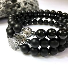 NEW! 3 styles of black onyx & hematite stretch bracelets to take you from casual to elegant. Choose from: • Clear quartz cube  • Celtic knot sphere • Celtic knot disc  Gift-ready packaging with original gift card too.
