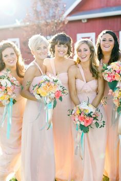 Pink Bridesmaids by Amsale with bright bouquets   Photography: BrumleyAndWells.com