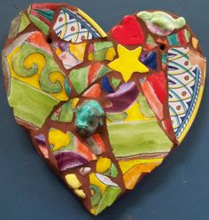 Heart, abstract design, mosaic.81/4x81/2. Hand made clay heart embellished with vintage painted shards. My handmade imagery.Brightly painted