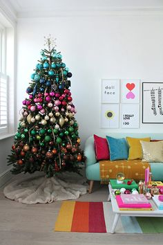 15 Christmas tree themes you'll want to recreate this holiday season Rainbow Christmas Tree, Real Christmas Tree, Christmas Tree Themes, Christmas Home, Christmas Tree Decorations, Christmas Tree Ornaments, Holiday Decor, Bohemian Christmas, Christmas Trends